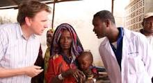 Oxfam CEO, Jim Clarken, visiting a clinic.