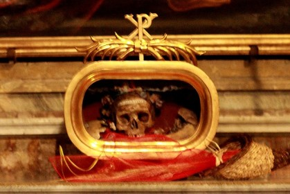 ... a small glass box containing a beflowered skull that held all the thoughts of St. Valentine himself, if you believe the label affixed to its forehead.