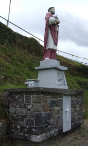 The one handed statue of Saint Moling and a poor box. This is a well on a substantial site in the middle of nowhere; but that is part of its rare beauty.