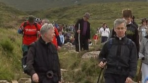 Archbishop Michael Neary with the papal nuncio, Archbishop Charles Brown, climbing the Reek.