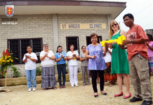 (Foreground, right to left) Cebu City Health Officer Dr Stella Ygonia and Dianne Duggan of SERVE gives to Tribal Chieftain Felecito Asamsa the key to the St. Brigid's Clinic, symbol of the Badjao community's ownership of and responsibility to the new health centre.
