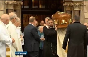 Redemptorists carry the coffin of their deceased confrere, Fr Alec Reid. Photo: RTE