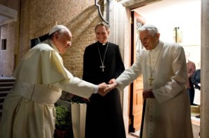 Pope Francis shakes hands with Pope Emeritus Benedict XVI at the Mater Ecclesiae monastery at the Vatican, December 23, 2013. Photo: REUTERS/Osservatore Romano