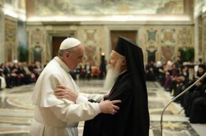 Pope Francis greets Ecumenical Patriarch Bartholomew.