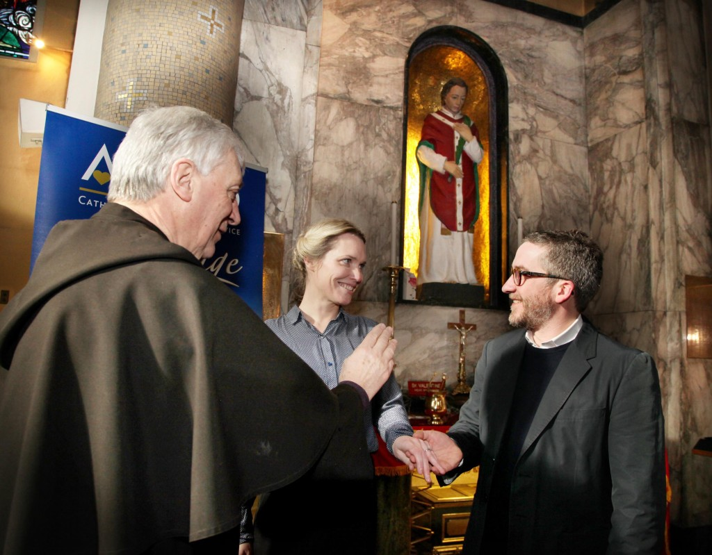 Fr Bernard Murphy O Carm blessed engaged couple Helen Young and Conor Kavanagh at the shrine of St Valentine in Whitefriar St Church in Dublin. The couple are due to get married in Rathfeigh Church in Diocese of Meath on 26th June this year. Pics John Mc Elroy.