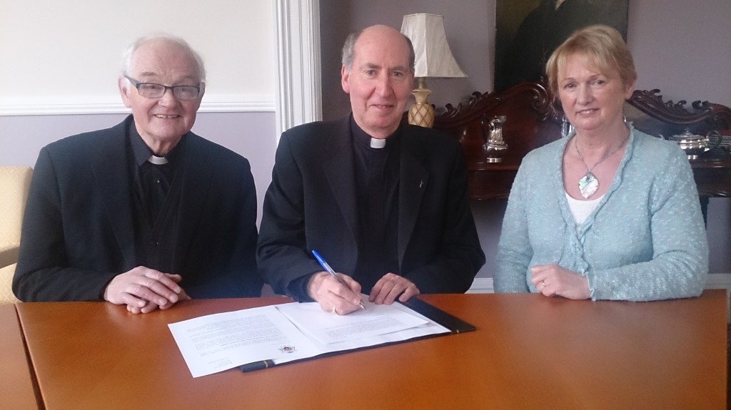 Bishop Denis Brennan signs letter to the priests of the Diocese of Ferns with Accord Chaplain Fr. Bill Cosgrave and Family Life Services co-ordinator Maria Kennedy.