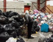 Clare Hallihan labels bags collected in Déise Philippines Appeal.