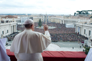 "Pope Francis waves as he delivers his first ""Urbi et Orbi"" message from the balcony overlooking St. Peter's Square at the Vatican"