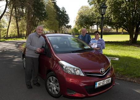 Bishop Kieran O'Reilly SMA, Bishop of Killaloe, blessing a new car for Mary & Pascal Hynds of Shannon and placing a car ticker of St John Paul on the car for safe travelling. Also in the photo is Fr Tom Ryan PP Shannon. Photo: Courtesy Joe Buckley.