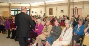 Mr George Dee addresses Provincial meeting SJYP Society.