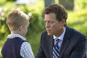 Greg Kinnear as Todd Burpo and Connor Corum as his Colton in Heaven is for Real.