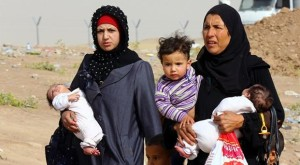Iraqi refugees fleeing from Mosul head to the self-ruled northern Kurdish region. Image courtesy: www.hurriyetdailynews.com