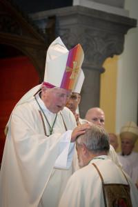 Bishop Christopher Jones prays over Bishop Kevin Doran. Photo: Clare Frances Photography.