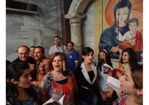 Cardinal Philippe Barbarin of Lyons sings with Iraqi Christians in a church in Kirkuk on 31 July.