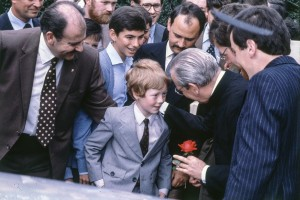 Dublin, 3 August 1980, an 8-year-old John Mullen gives a rose to Venerable Alvaro del Portillo who asks him to place it beside the tabernacle.