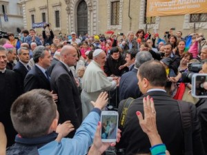 Pope Francis visiting the church of Santa Maria in Trastevere during a visit to the Sant'Egidio community in Rome