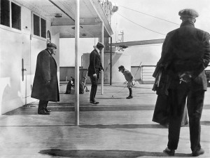 Robert Douglas Spedden, watched by his father Frederic is playing on deck n the Titanic with a spinning top. Image: Fr Frank Browne (1912)