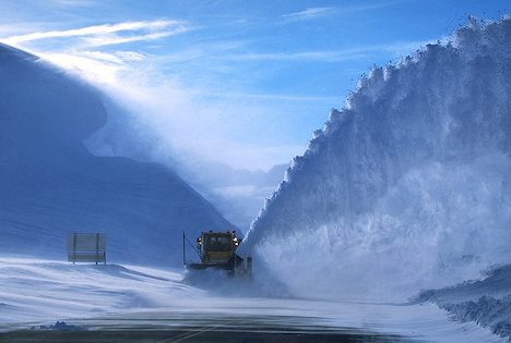 Grader clears highway after heavy snow fall