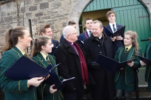 Archbishops Eamon Martin and Richard Clarke sing Christmas carols with students from the ROyal College and St Catherine's in Armagh.