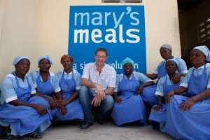 Magnus MacFarlane-Barrow with Mary's Meals Volunteers in Haiti.