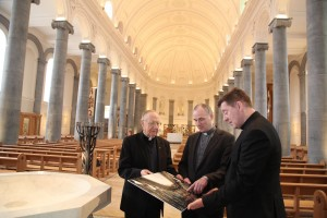 Bishop Emeritus Colm O'Reilly, Fr Tom Healy Administrator of St Mel's Cathedral and Bishop Francis Duffy, Bishop of Ardagh and Clonmacnois looking at a photograph of the fire damaged Cathedral during the press viewing on Friday. Pic John McElroy.