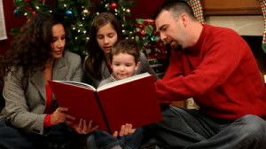 stock-footage-family-reading-a-book-at-christmas-time