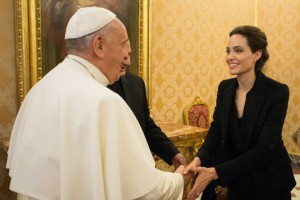 Pope Francis meets director Angelina Jolie following the screening of her film 'Unbroken' at the Vatican. Pic courtesy: time.com