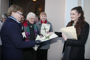 Pic shows a student from Holy Faith School Killester distributing St Brigid's Crosses which they made as part of Catholic Schools Week after the mass. Pic John Mc Elroy.