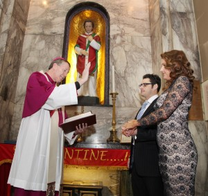 At the Shrine of St Valentine in Whitefriar St in Dublin, engaged couple Leona Gallagher from Castledawson Co Derry and Paul McNulty from Beaumont in Dublin were blessed by Bishop Denis Nulty. Pic John Mc Elroy.