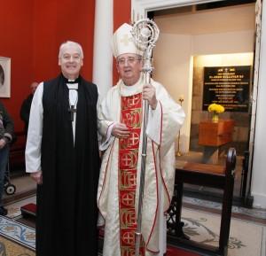 Archbishop Michael Jackson and Archbishop Diarmuid Martin beside the tomb of Venerable Fr John Sullivan (1861-1933). Pic John McElroy.