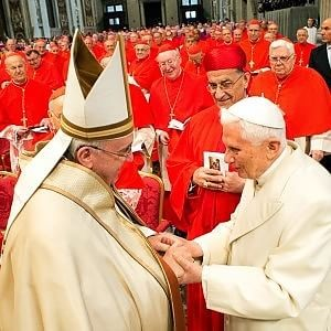 Pope Francis and Pope Emeritus Benedict XVI in St Peter's Basilica for the Consistory Mass on 14 February 2015. Photo: www.news.va