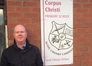 Fr Tony O'Riordan outside Corpus Christi primary school in Moyross. Pic: Irish Catholic