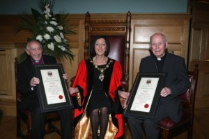 Bishop James Mehaffey, retired Church of Ireland Bishop of Derry and Raphoe, and Bishop Edward Daly, retired Bishop of Derry, with the Mayor of Derry, Brenda Stevenson, as she bestowed the Freedom of the City on the two religious leaders.  Image: Courtesy Derry Journal