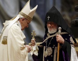 Pope Francis is greeted by the head of Armenia's Orthodox Church Karekin II, during an Armenian-Rite Mass on the occasion of the commemoration of the 100th anniversary of the Armenian Genocide, in St Peter's Basilica, at the Vatican, Sunday, April 12, 2015. (AP Photo/Gregorio Borgia)
