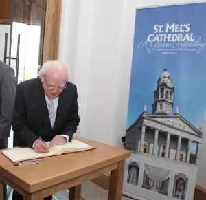 President Michael D. Higgins signing the visitors book on his arrival at St Mel's Cathedral Longford. Pic John Mc Elroy.