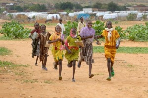 Girls hurry to school in the Dereig Camp for internally displaced persons. The camp's schools are supported by ACT-Caritas.