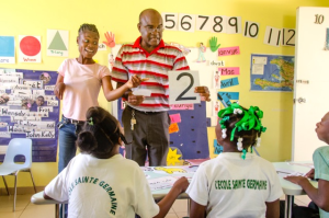 Teacher Frantz Desir and Assistant Darline Milord put on a lively display they teach Klas Ibiscus maths. Photo: NPH Haiti.
