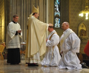 Archbishop Eamon Martin lays his hands on Fr Aidan McCann during his ordination.   Ordination to the Priesthood of Brian Slater and Aidan McCann   St Patrick's Cathedral Armagh   5 July 2015  Credit: LiamMcArdle.com