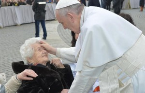 Pope blessing old woman