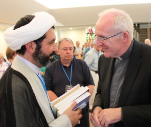 Dr Mohammed Ali Shomali greets Bishop Brendan Leahy at 'Signs of Hope' Liverpool