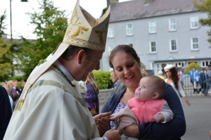 Primate Eamon Martin and baby in Knock