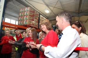 Pic shows Tanaiste and Minister for Social Protection Joan Burton cutting the ribbon with Crosscare staff Valerie Cummins (food bank manager) and Michael McDonagh (Senior Manager for food and outreach) at the opening of the Foodbank in Glasnevin Dublin. Pic John Mc Elroy.