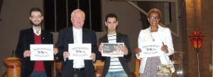 \msgr Byrne with brothers Osama and Amro Abouhajar from Syria and Patricia Murambinda from Zimbabwe