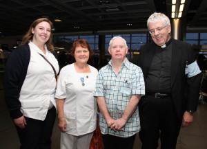 Nurses Jenny Navan, Bridget Mulligan, pilgrim David Morgan and pilgrimage director Fr Martin Noone at Dublin Airport on Monday morning waiting to board their flight to Lourdes. Pic John Mc Elroy.