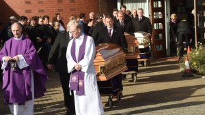 Fr Derek Farrell, parish priest at the Parish of the Travelling People and Mgr Dermot Lane, parish priest of Ballaly at the funeral of the Connors family. Pic courtesy: Independent.ie
