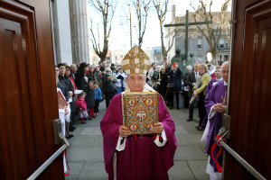 20/12/2015 NO REPRO FEE, PIC MAXWELLS/JULIEN BEHAL To mark the Jubilee of Mercy initiated by Pope Francis , Archbishop Diarmuid Martin opened a Door of Mercy at St. MaryÕs Pro-Cathedral, Marlborough Street, Dublin.Picture shows Archbishop Diarmuid Martin holding the Gospel at the door.The door chosen by Archbishop Martin leads into an area of the Pro-Cathedral that has two confessionals, a statue memorial to Venerable Matt Talbot, whose life was healed from addiction when he encountered GodÕs mercy and also looks to the altar of St Laurence OÕToole, patron of the Archdiocese, celebrated as a man of mercy. - See more at: http://www.dublindiocese.ie/archbishop-opens-holy-door-of-mercy/#sthash.JIp8XGZW.dpuf PIC MAXWELLS/NO FEE