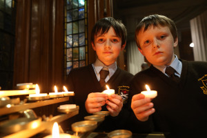 Pic shows twin brothers Ciaran (left) and Andrew Nolan aged 11 as they light candles after the Mass. The two boys attend St Clare's primary school Harolds Cross, Dublin.Pic John McElroy