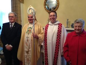 Bishop Seamus Freeman sac and Rev Rev Brendan McCarrick sac with his parents.