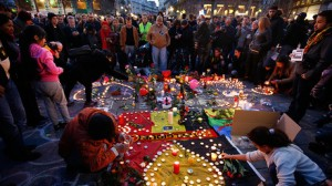 People gather around a memorial in Brussels following bomb attacks in Brussels. Pic courtesy: https://www.rt.com/