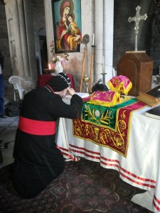 Bishop Selwanos celebrating the first mass in the St. Mayrs Church - Syrian Orthodox in Homs after the rebels left.